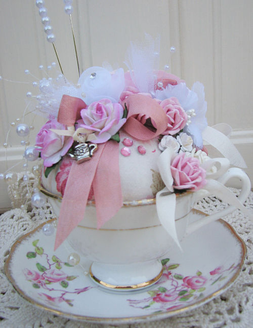 Teacup Pincushion Blooming With Pink Roses-teacup,saucer,pincushion,roses,cottage,vintage,gold,someplaceinthyme,pink,pearls,pins,ribbons,paper,silk,charm,silver,shabby,chic,gift,handmade