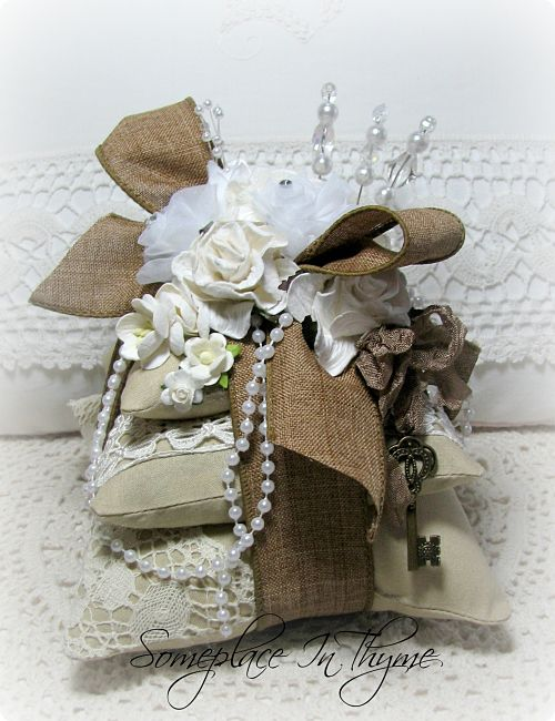 Pincushion Sachet In Naturals With Lace-pincushion, sachet, ribbons, home decor, decoration, handmade roses, pearls, lace, vintage, key charm, lavender buds, beaded pins, venise lace, cottage decor, shabby decor